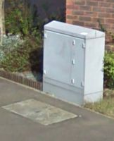 This is the cabinet with a BT manhole cover in front of it